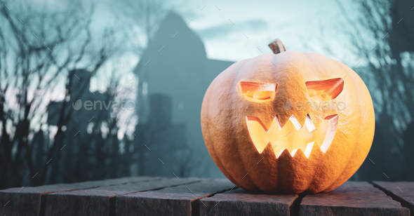 Halloween pumpkin glowing on gothic graveyard. - Stock Photo - Images