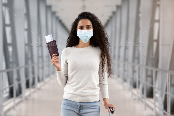 Pandemic Travels. Happy Young Woman In Protective Medical Mask Posing In Airport - Stock Photo - Images