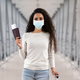 Pandemic Travels. Happy Young Woman In Protective Medical Mask Posing In Airport - PhotoDune Item for Sale