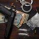 Drugs smuggling and trafficking, Handcuffs, pistol money and cocaine on wooden table background - PhotoDune Item for Sale
