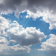 Fluffy cumulus clouds on blue sky background. Cloudscape white and grey color - PhotoDune Item for Sale