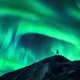 Northern lights and silhouette of woman with raised up arms - PhotoDune Item for Sale
