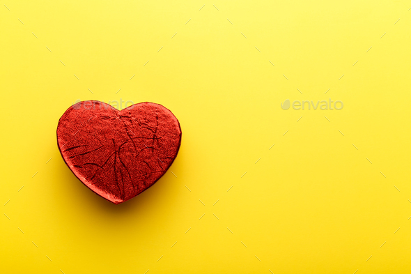 Red heart on yellow background - Stock Photo - Images