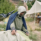 Refugee Man Covering Tent With Sack - PhotoDune Item for Sale