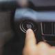 Hand pushing car start engine button - PhotoDune Item for Sale