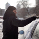 Adult man removing snow from the car with brush - PhotoDune Item for Sale
