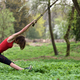 Young attractive woman does body stretching with trx fitness straps in the outdoors - PhotoDune Item for Sale