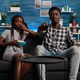 POV of black married couple on couch watching television - PhotoDune Item for Sale