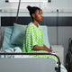 Young african american person sitting on hospital ward bed - PhotoDune Item for Sale