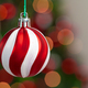 Red and white bauble hanging from a Christmas tree - PhotoDune Item for Sale