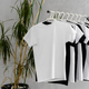 Row of black and white t-shirts hanging on rack - PhotoDune Item for Sale