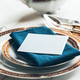 Close up shot of table setting for fine dining with cutlery and glassware - PhotoDune Item for Sale
