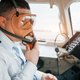 In oxygen mask. Pilot on the work in the passenger airplane. Preparing for takeoff - PhotoDune Item for Sale