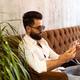 Entrepreneur uses phone mobile. Young handsome businessman arab muslim in business center - PhotoDune Item for Sale