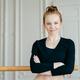 Satisfied self confident ballet dancer crosses hands over chest, stands near barres - PhotoDune Item for Sale