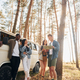 Group of young people is traveling together in the forest at daytime - PhotoDune Item for Sale
