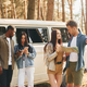 Standing near the car. Group of young people is traveling together in the forest at daytime - PhotoDune Item for Sale