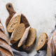 Top view of two brown baguettes on a concrete background. - PhotoDune Item for Sale