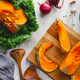Top view of roasted pumpkin slices on a wooden board. - PhotoDune Item for Sale