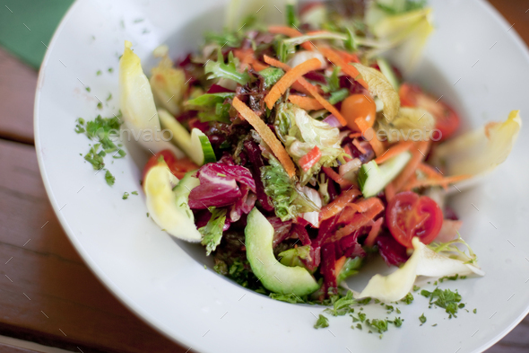 Appetizing mixed salad on a plate - Stock Photo - Images