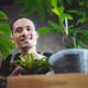 young Asian man are happy with growing plant in small green garden at home, hobby lifestyle - PhotoDune Item for Sale