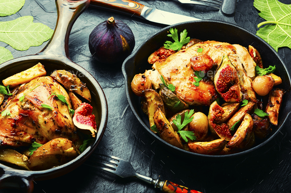 Chicken baked with potatoes and figs - Stock Photo - Images