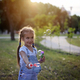 Kid blowing soap bubbles outdoor - PhotoDune Item for Sale