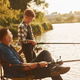 Sunny weather. Father and son on fishing together outdoors at summertime - PhotoDune Item for Sale