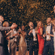 Group of beautiful people in formalwear having fun together with confetti flying all around - PhotoDune Item for Sale
