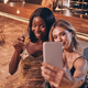Two beautiful women in evening gowns making selfie and smiling while spending time on luxury party - PhotoDune Item for Sale
