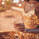 Close-up of beautiful young African woman in evening gown holding flute with champagne - PhotoDune Item for Sale