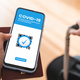 Digital certificate of covid vaccination app - Traveler holds health immunity passport on smartphone - PhotoDune Item for Sale