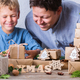 Creative zero waste Christmas concept, father and son wrapping gifts - PhotoDune Item for Sale