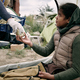 Giving Canned Food To Refugee Girl - PhotoDune Item for Sale