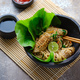 Hot noodles with squid in stone plate, copy space. Asian food concept - PhotoDune Item for Sale