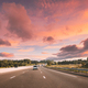 movement of vehicles on freeway, motorway during sunset time - PhotoDune Item for Sale