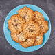 Fresh baked homemade healthy oatmeal cookies on blue plate. Delicious dessert - PhotoDune Item for Sale