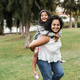 Happy indian mother having fun with her daughter outdoor - Focus on mother face - PhotoDune Item for Sale