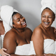 Multigeneration women with diverse skin and body laughing together while wearing body towels - PhotoDune Item for Sale
