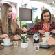 Young friends having fun drinking coffee at vintage bar - Focus on right girl face - PhotoDune Item for Sale