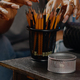 Close up of art tools and pencils on table in artwork space - PhotoDune Item for Sale