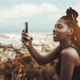 Black girl photographing a cityscape - PhotoDune Item for Sale
