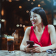 Laughing Asian girl in a night bar - PhotoDune Item for Sale
