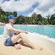 Man on boat against beautiful beach - PhotoDune Item for Sale
