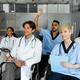 Multiracial team of doctors having professional training - PhotoDune Item for Sale