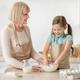 Happy senior woman and her granddaughter preparing dough - PhotoDune Item for Sale