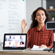 Smiling young woman teaching english to students online, waving hello - PhotoDune Item for Sale