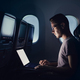 Man using laptop in airplane - PhotoDune Item for Sale