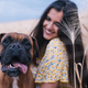 Close up view of a young happy woman hugging her dog in the middle of a wheat field - PhotoDune Item for Sale