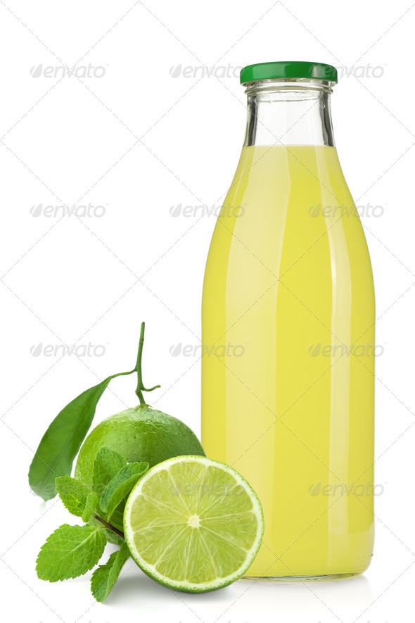 Lime juice bottle, ripe limes and mint - Stock Photo - Images